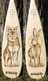 Wood-burned paddles by Canoe Museum instructor Cara Jordan