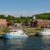 Boats on the Trent-Severn Waterway with the Campbellford Clock Tower Cultural Centre in the background.