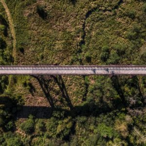 Aerial view of cyclists crossing Doube's Trestle Bridge on the Kawartha Trans Canada Trail