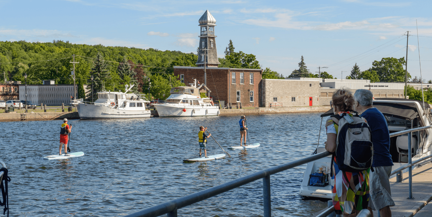 SUP Paddlers in downtown Campbellford on the Trent-Severn Waterway.