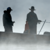 Two fisherpeople on a foggy lake in Kawarthas Northumberland
