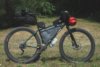 A mountain bike loaded with gear and supplies