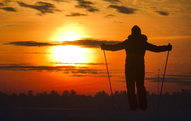 Cross Country skier greets the rising sun