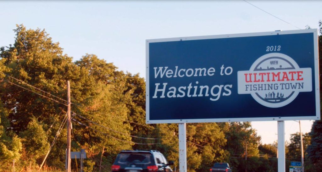 """Road sign that reads """"Welcome to Hastings Ultimate Fishing Town"""""""