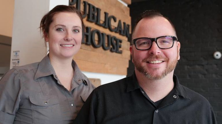 Chefs Brad Watt and Rebecca Burke stand in the foyer of the Publican House Brew Pub