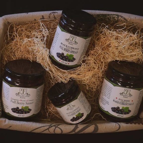 A basket containing black currant products from Popham Lane Farm