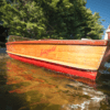 Wooden boat with Lakefield written on the hull