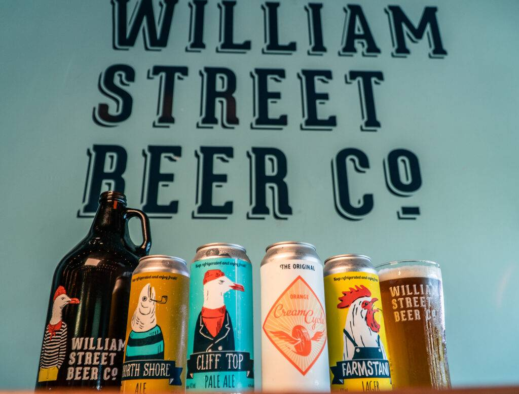 William Street Beer Co. craft beers in front of brewery sign