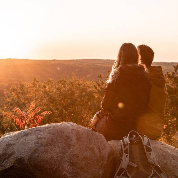 A couple looks out over a viewpoint in Northumberland County