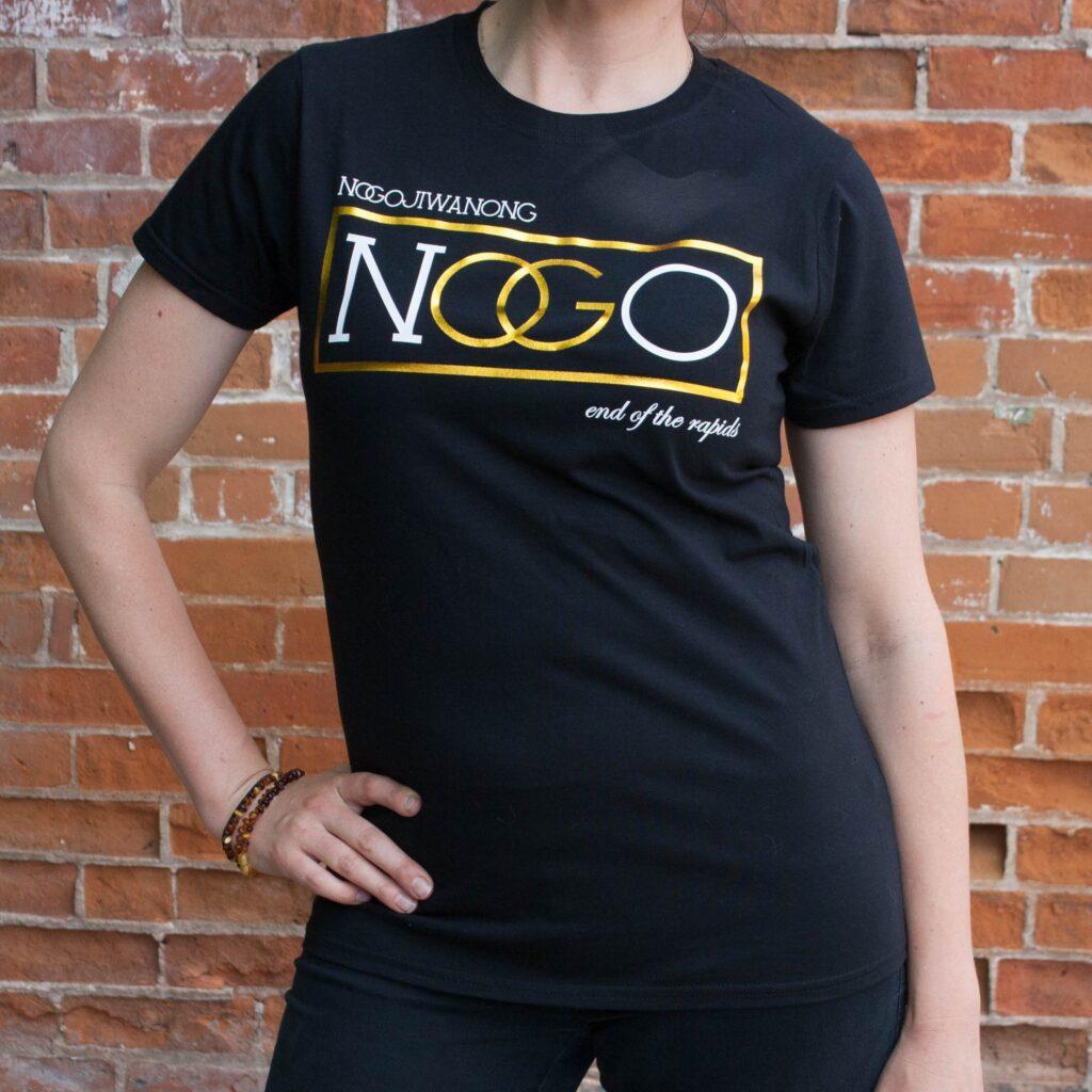 "Shirt by Nish Tees that reads ""Nogojiwanong"""
