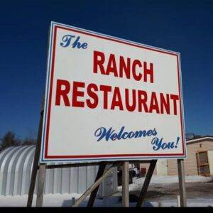 """Closeup of an outdoor sign that reads, """"The Ranch Restaurant Welcomes You!"""""""