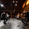 Members of the New Orford String Quartet perform in the barn at Westben during the filming of digital concert