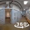 Interior of Olde Gaol Museum showing open cell door
