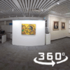 Interior of Kawartha Art Gallery showing a yellow painting in the midground